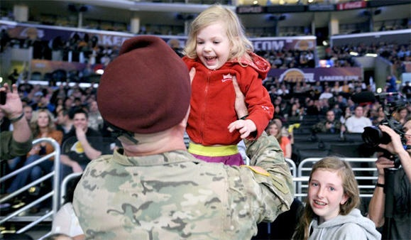 The face of coming home from battle ... you can't beat that look of joy! U.S. Army airborne officer reunited with family, 25 January 2013.