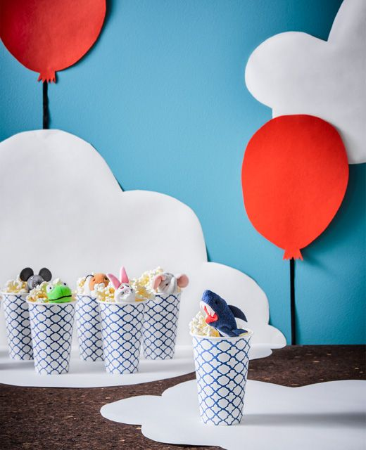 Fill paper cups with popcorn and a finger puppet to make a fun party favour for kids | #IKEAIDEAS #partyplanning #kids