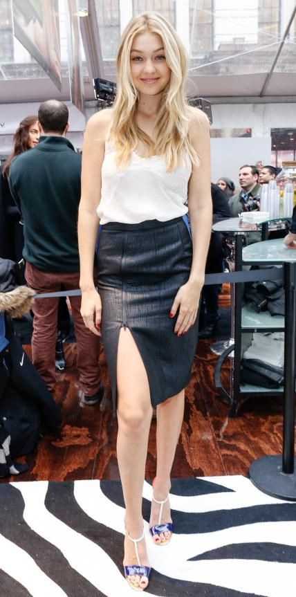 """New """"It"""" model Gigi Hadid made an entrance at the Sports Illustrated Swimsuit 2015 fan event in a white cami that she elevated with a faux leather Katharine Kidd pencil skirt and color-block T-strap sandals."""