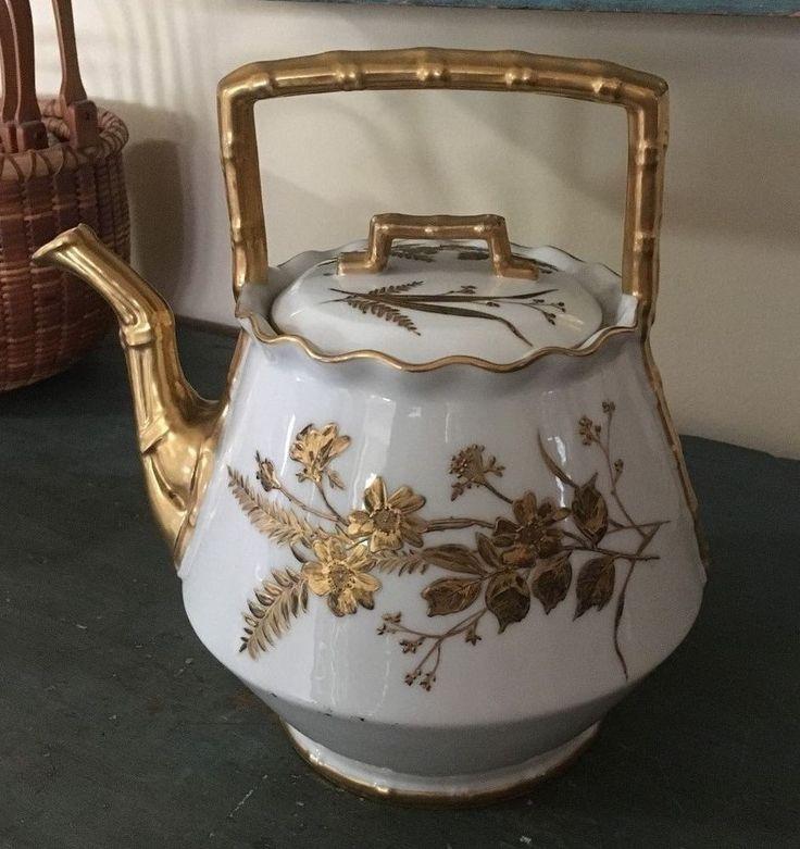 Antique T & V Limoges depose white teapot with gold decoration, gold gilt bamboo handles & spout. Antique porcelain tea pot. Undated.