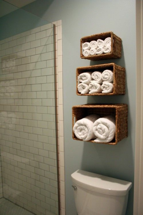To Do in Bathrooms:  Hang sideways baskets on open wall space to create more storage areas.  Like the idea of organizing towels by size.