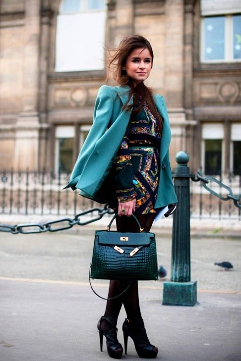 Teal blazer over a gorgeous multi-colored dress paired with jet black nylons!