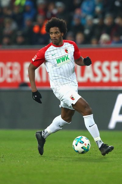 Caiuby Francisco da Silva  of Augsburg runs with the ball during the Bundesliga match between FC Augsburg and VfL Wolfsburg at WWK-Arena on November 25, 2017 in Augsburg, Germany.