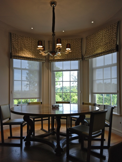 This timeless pendant hangs decoratively and with the downlights provides sufficient lighting throughout .