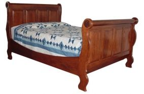 Amish Craftsman sleigh bed hand crafted of solid hardwood. Available in various sizes and finishes.