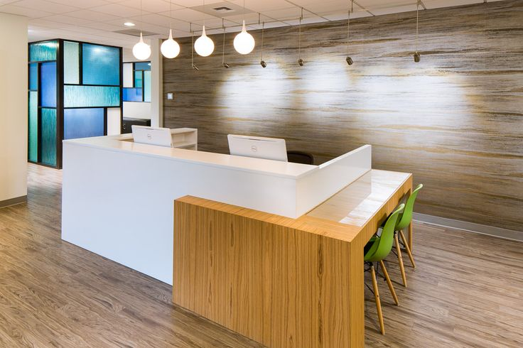 Great front desk layout with Lumicor wall in Background! #Lumicor #interiordesign #frontdesk #interior #design #chiropractic