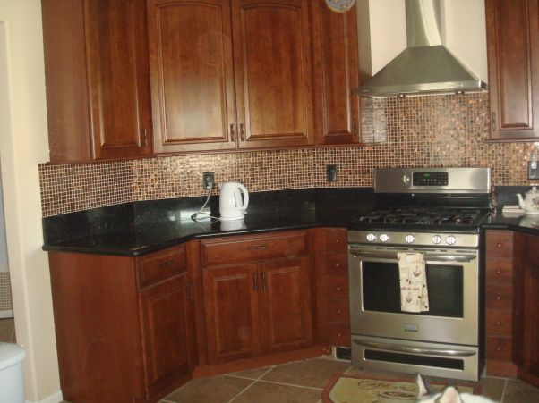 Backsplash ideas for black granite countertops cherry for Backsplash ideas with black cabinets