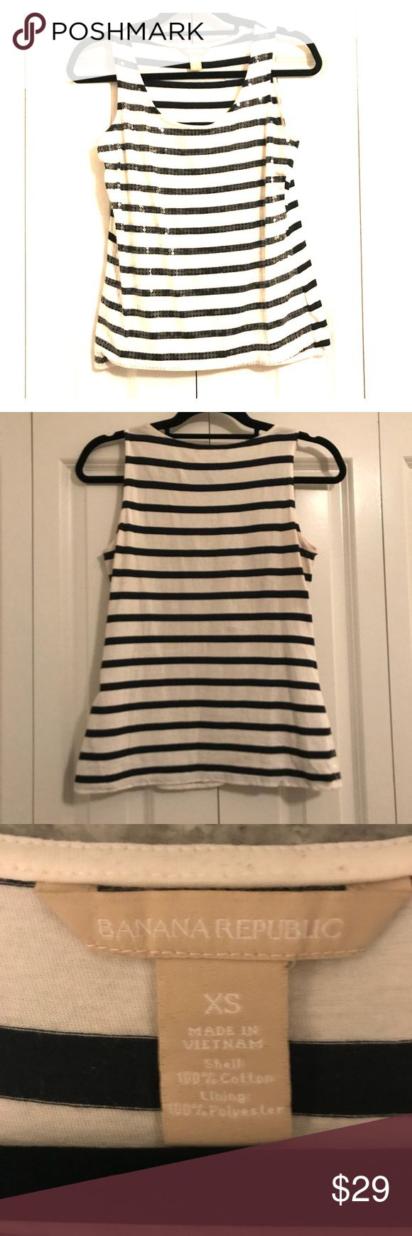 Banana Republic Navy and white tank Navy and white striped tank with sparkly details. In excellent used condition. Machine washable. Great with jeans or under a blazer to dress it up. Super comfy. Back is more of a jersey material. Hits below the waist line. Smoke free/pet free home. No defects. Banana Republic Tops Tank Tops