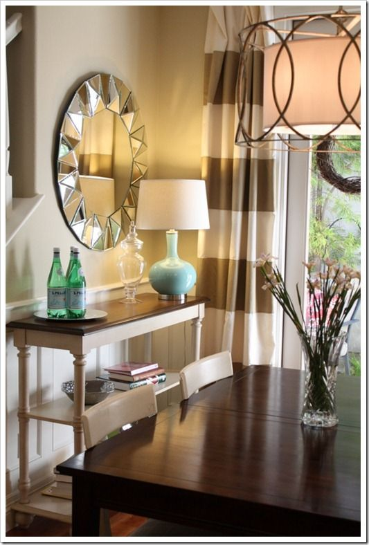 curved lamp, open shelving console table and horizontal striped