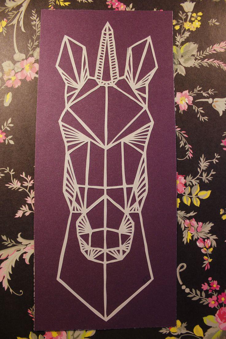 "Hand cut geometric unicorn head from single sheet of white metallic paper, mounted on shimmery purple/maroon quality card.10.5"" X 4.5"""