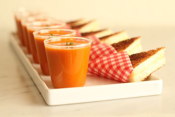Shot glass tomato soup and grilled cheese sandwich bites.