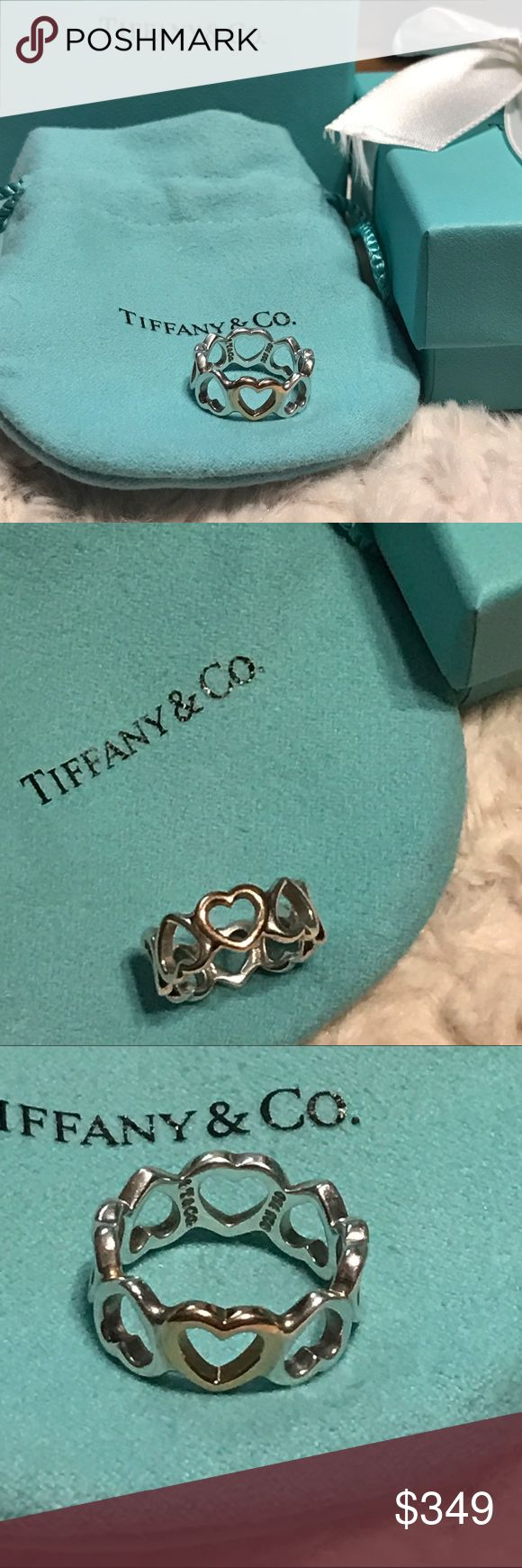 TIFFANY Heart Ring SZ 4 Valentines Gift AUTHENTIC NWOT AUTHENTIC 💯 Tiffany & CO Sterling Silver 18K Rose Gold Heart Ring Size 4 -1 heart is rose gold. Others are Sterling Silver which makes it very versatile because you can wear with any piece of jewelry  100000% AUTHENTIC & fully hallmarked.   GET 1 Ring, ONE Tiffany & CO. box, ribbon, & pouch  👍🏼I NEVER buy or sell fakes 💗look @ my closet for great deals 🚫trades/returns ❤️PRICE FIRM CANNOT bundle  📦Fast shipping   🎥 I VIDEO RECORD…