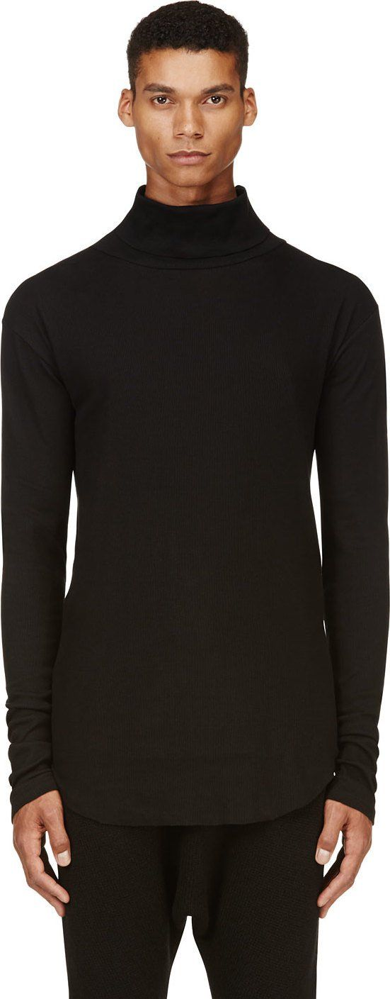 Overlong ribbed turtleneck in black. Curved raw-edge hem. Tonal stitching.