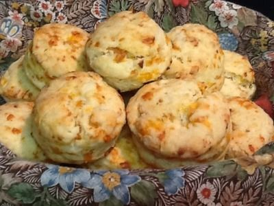 NEIMAN MARCUS CHEDDAR CHEESE BISCUITS.  Dallas's Neiman Marcus department store dining room served these rich, fluffy biscuits gratis with every meal. Retaining the original Neiman Marcus recipe, here is an updated version incorporating current trends of ginger, bacon, and apricots.