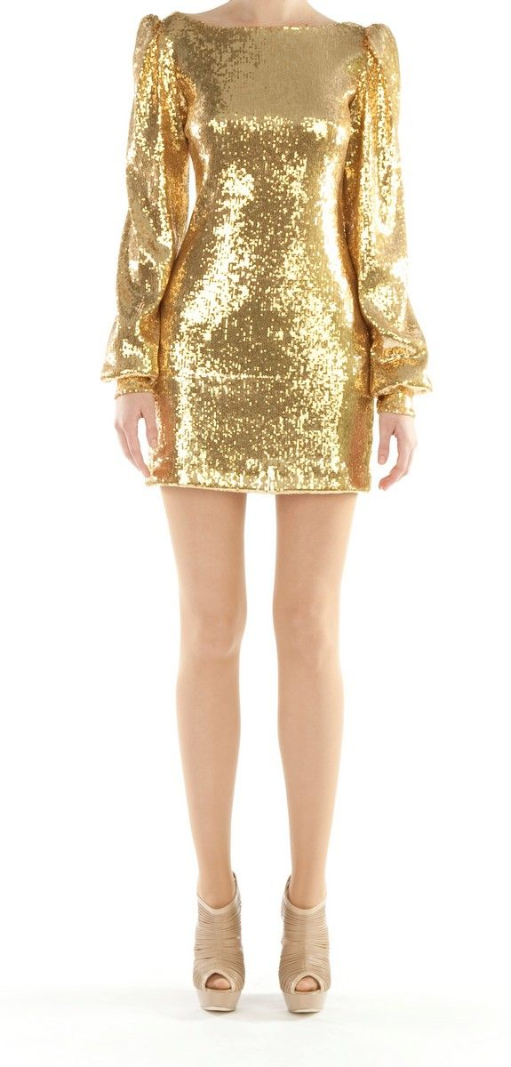 Designed by Narces, this gold sequinned backless mini dress will make you the stand out at any party.  Available in size 4 through Pinktiger.com.