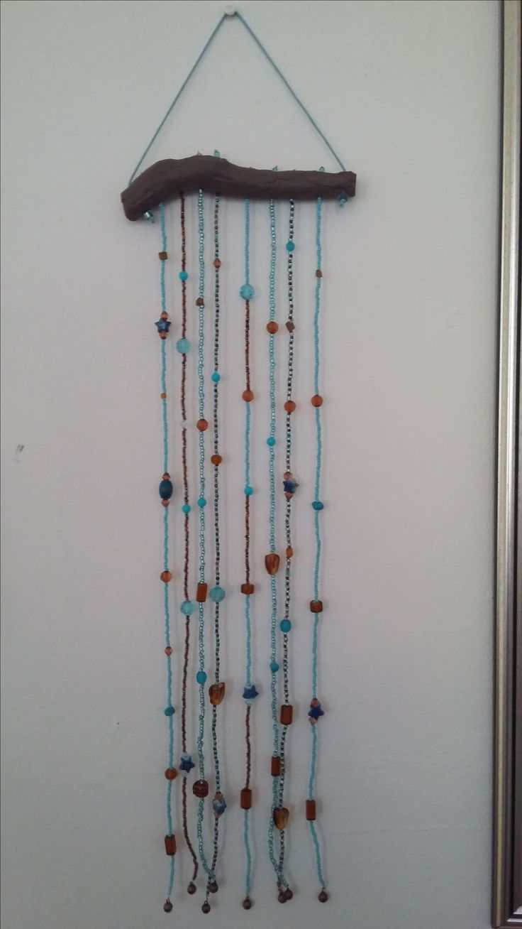 Angel wind chime in turquoise and brown. <3