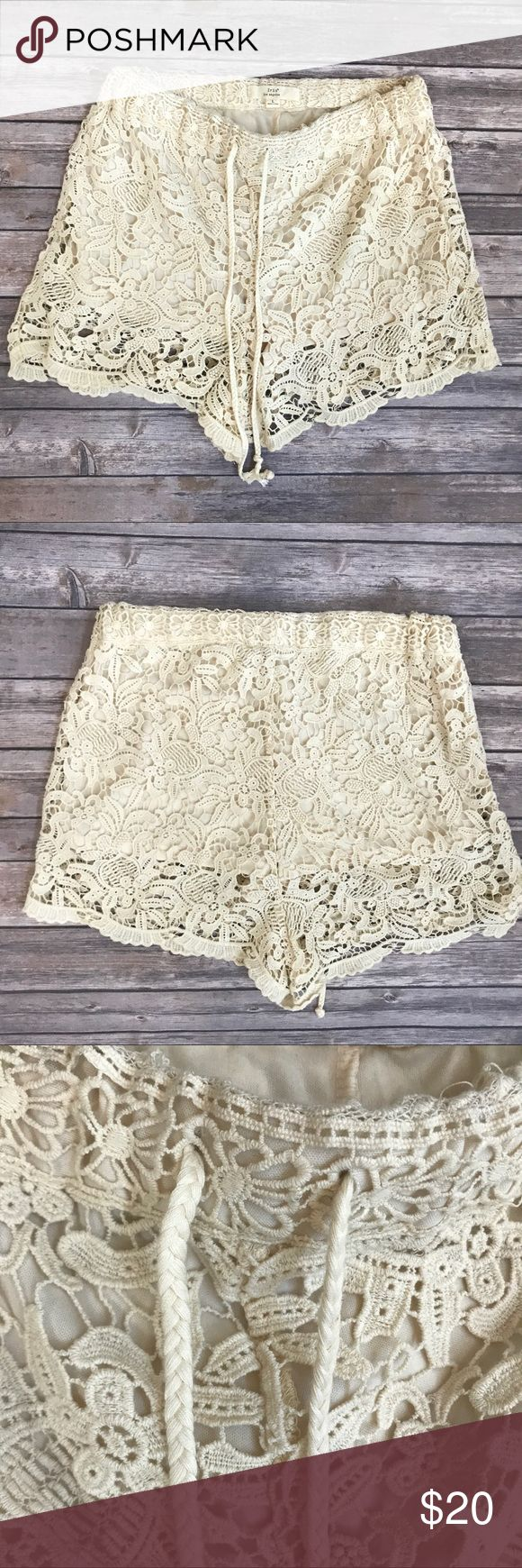 "Lace overlay festival summer shorts boho Sz large NEW Iris Los Angeles Womens Cream Shorts Lace Crochet Festival Knit Sz L NWOT  Iris Los Angeles NEW without tags   Decorative Layer Knit Shorts   Elastic Waist, Drawstring Front   FEATURES  Color: Peach  Size: Large  Waist: 15"" drawstring  Rise: 13""  Length(middle waist to hem): 15.5""  Inseam: 3""   CONTENT  Shell 1 - 100% Cotton  Shell 2 - 100% Polyester iris los angeles Shorts"