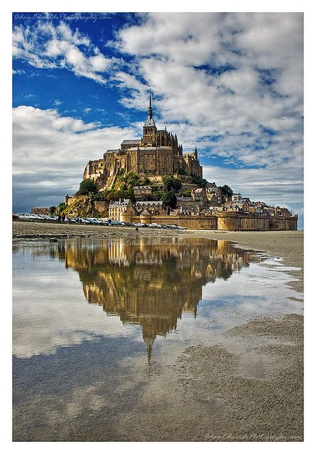 Mont St. Michel is a rocky tidal island and a commune in Normandy, #France. It is located approximately one kilometre off the country's north-western coast, at the mouth of the Couesnon River near Avranches. The island has been a strategic point holding fortifications since ancient times. The Mont-Saint-Michel and its bay are part of the #UNESCO list of World Heritage Sites. (Photograph by Adam Edwards) www.adamedwardsphotography.com