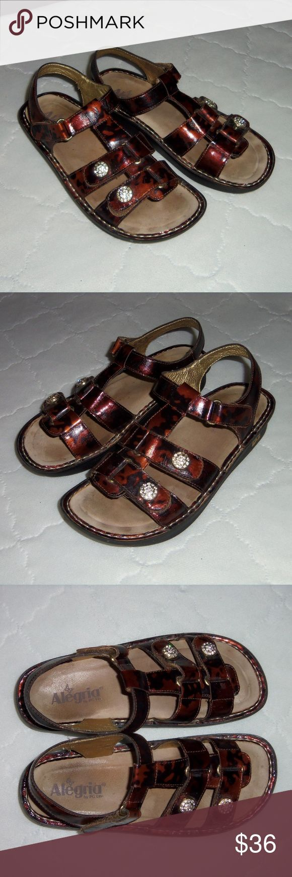 Alegria sandals brown black bling 39 Nice pair of Alegrias! EUR 39 approx. equivalent to US 8.5 to 9.  Genuine leather upper, velcro adjustable with crystal bling on corners of front straps. Minor wear, some wear on heels see all pictures!! Alegria Shoes Sandals