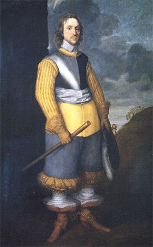 Oliver Cromwell by Robert Walker, tentatively dated to 1650, in the surprisingly 'gay attire' of 'petticoat breaches', lacy boot-hose and a plumed hat.