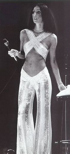 Cher on stage 1970's. ☚ | wow | fashion | black & white | sparkle and shine | sequin jumpsuit | www.republicofyou.com.au