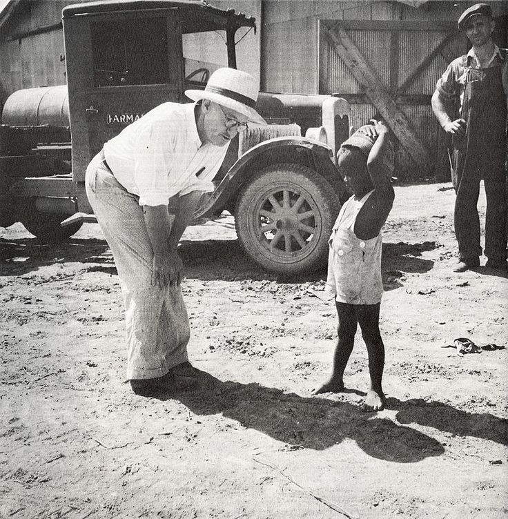 The owner of the Aldridge Plantation with one of the plantation children Leland (vicinity) June 1937.jpg