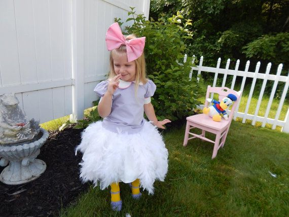 This is for one custom made Daisy Duck inspired costume. It includes a blouse…