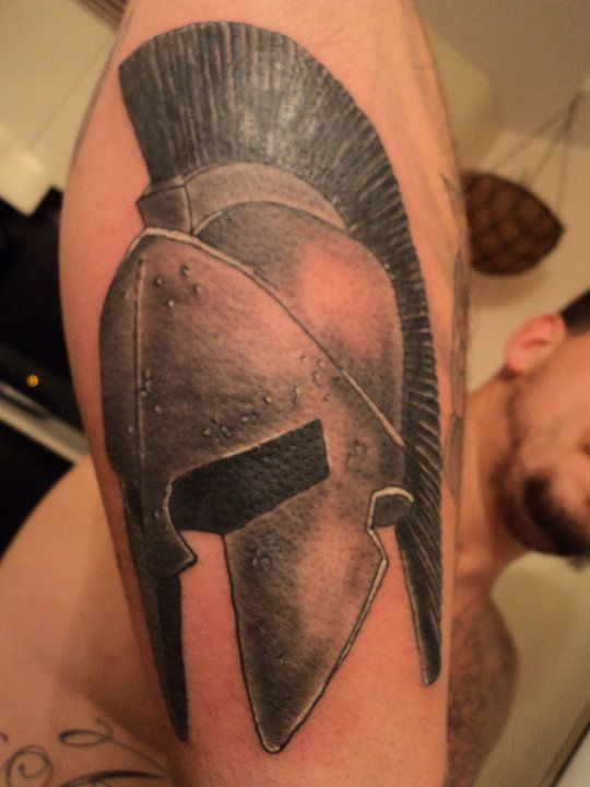 what does a spartan helmet tattoo mean