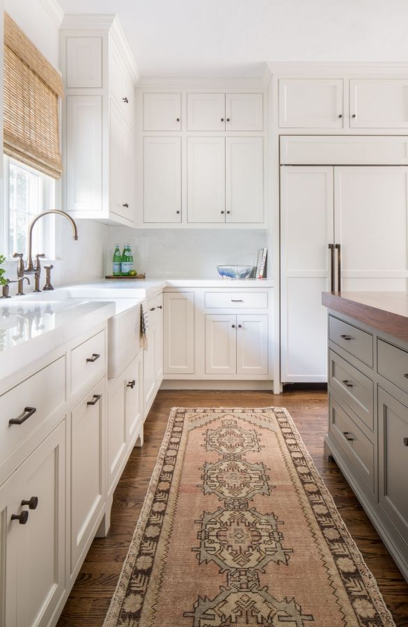 kitchen design, wood floors, l-shaped, Chelsea gray painted island, ceiling height wall shaker cabinets, bamboo blind, farmhouse sink, fridge