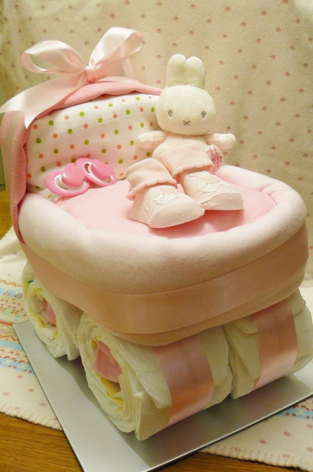 """Amazing nappy cake idea for girls Miffy Cutie Pie Pink Pram - This is a large gift created into a beautful baby pram.  It definitely has the """"wow"""" factor!"""