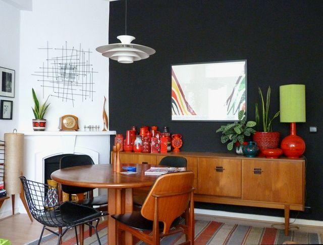 mid century modern interior with Danish Poul Hennigsen Louis Poulsen lamp....black wall is amazing-makes teak look gorgeous!!!