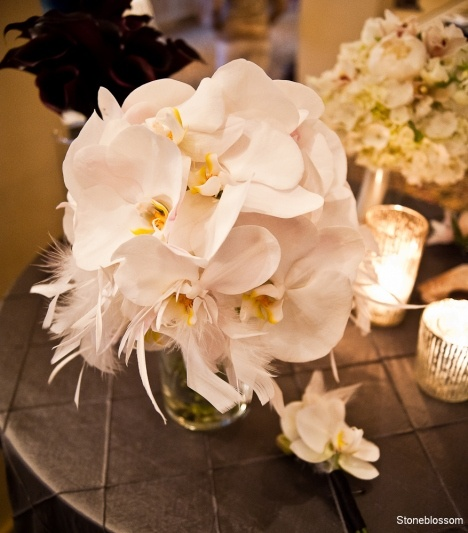 sultry orchid bouquet & boutonniere with feathers
