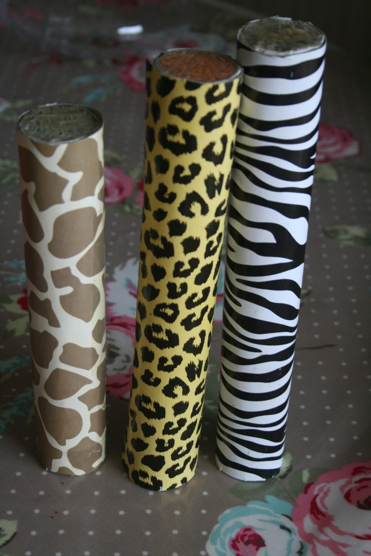 Baby Size Rain Sticks using sturdy cardboard tubes, little nails, panel pins, tapped randomly entire length of tube, ends taped securely after pouring in a scoop of a different filling for each: Pearl Barley, Red Lentils, Rice. Tube covered with jungle print Contact Paper. Might see if mailing tubes would work because they have a cap.