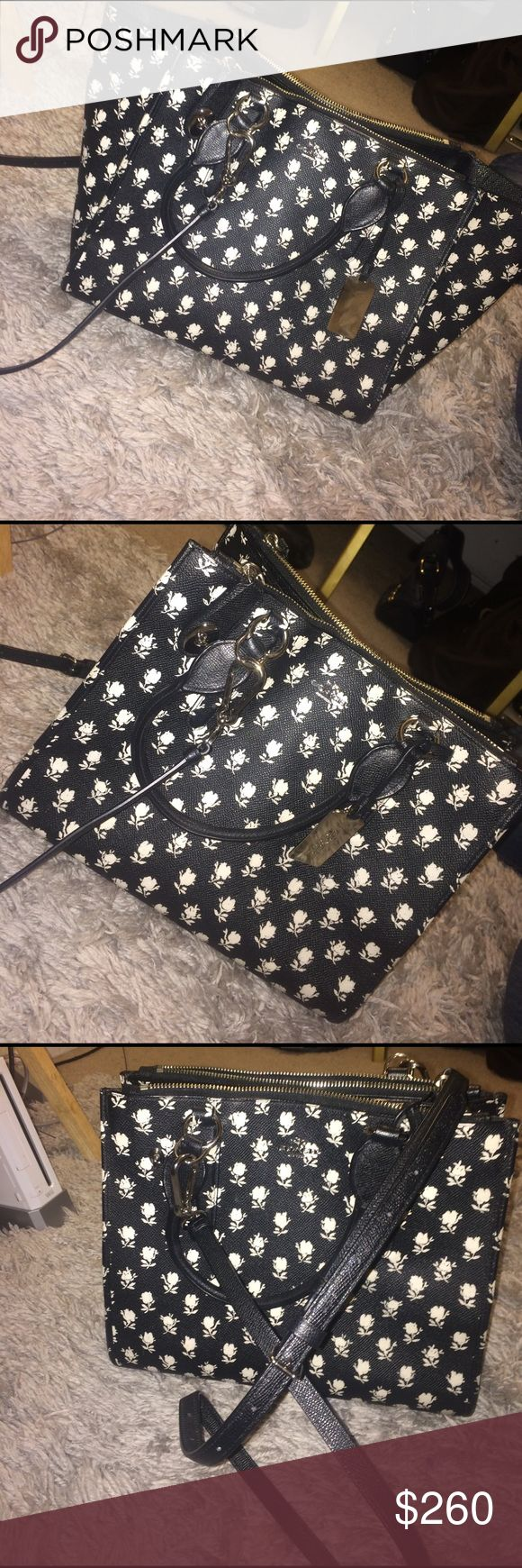 Coach leather floral All black leather coach purse, retail, used only twice, with creme floral pattern. , comes with shoulder strap, or hand carry, two openenings at the top which you can lock on the side of the purse also three packets inside. If you need a size let me know Coach Bags Shoulder Bags