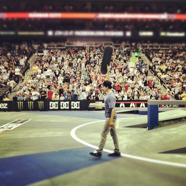 Nyjah Huston raises his board in victory after winning the first stop of the 2012 Street League Skateboarding DC Pro Tour.