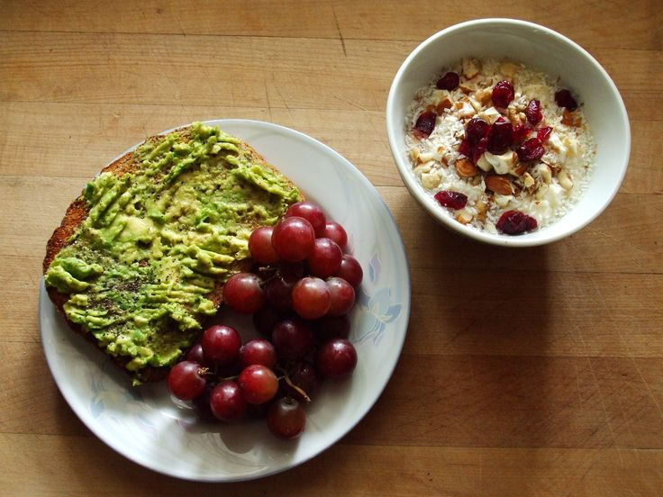 whole grain flax toast with avocado, salt, and pepper, red grapes, almond silken tofu with almonds, cashews, walnuts, coconut, and cranberries