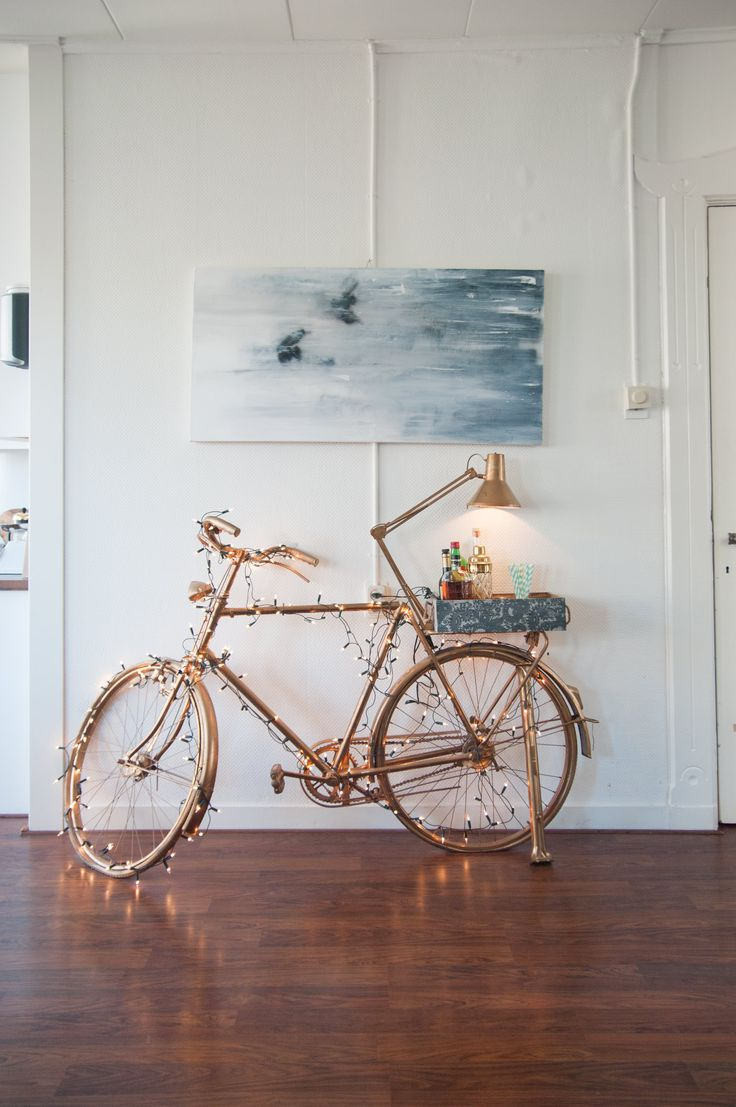 My original artwork hangs above the statement piece of the living space: a golden bike bar that I made myself.