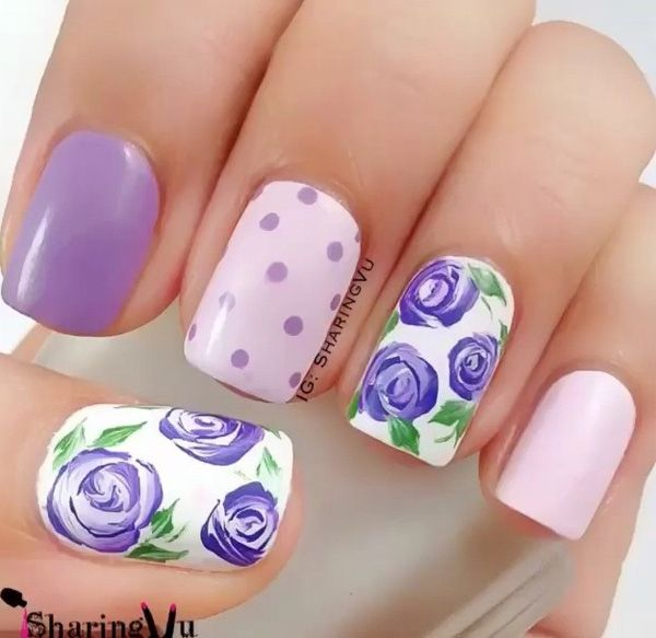 Lovely Purple nail art floral design. Florals are always very pretty to look at…