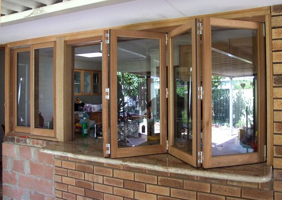 In keeping with my gorgeous new parterre garden courtyard, I am going to need to replace the yukky aluminium window that looks out onto it. A servery window like this would be ideal.