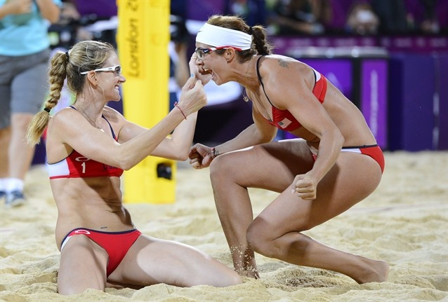 Misty May-Treanor and Kerri Walsh (left) embrace after winning the gold medal after defeating April Ross and Jennifer Kessy (USA)