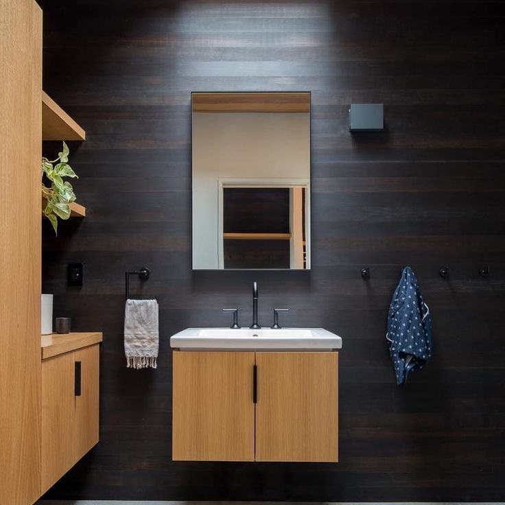 The Jason Wu For Brizo Bath Collection Complements Black Dyed Fir Paneling  For Sultry Color Contrast