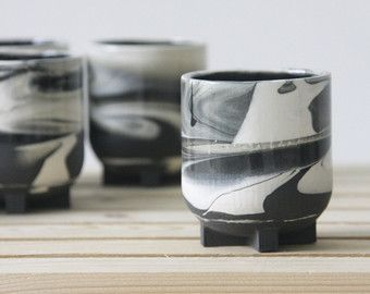 Set of 2 ceramic cup in gray and white. The cup is half dipped in glossy glaze and has a unique and modern look. Makes a great gift for Christmas. The cup is made in slip casting technique. Each cup is treated separately and burned to high temperature. approximate size: 2.5 W x 2.5 H   6.5 cm W x 9 cm H Capacity of 220 ml  The cup is drinking, eating and dishwasher safe. I do not recommend putting them in the microwave or oven. Hand washing is always preferred for any handmade piece. Handle…