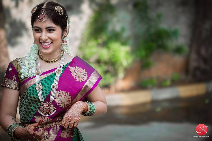 South Indian bride.Gold Indian bridal jewelry.Temple jewelry. Jhumkis. Green and fuschia pink silk kanchipuram sari.Braid with fresh flowers. Tamil bride. Telugu bride. Kannada bride. Hindu bride. Malayalee bride.Kerala bride.South Indian wedding