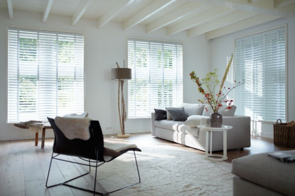 Venetian blinds in white with matching tape.