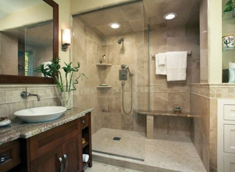 Warm colored marble, natural granite tones, a maple vanity, and an open airy shower and drying area are at the heart of the well-composed welcoming space of this in-home luxury spa
