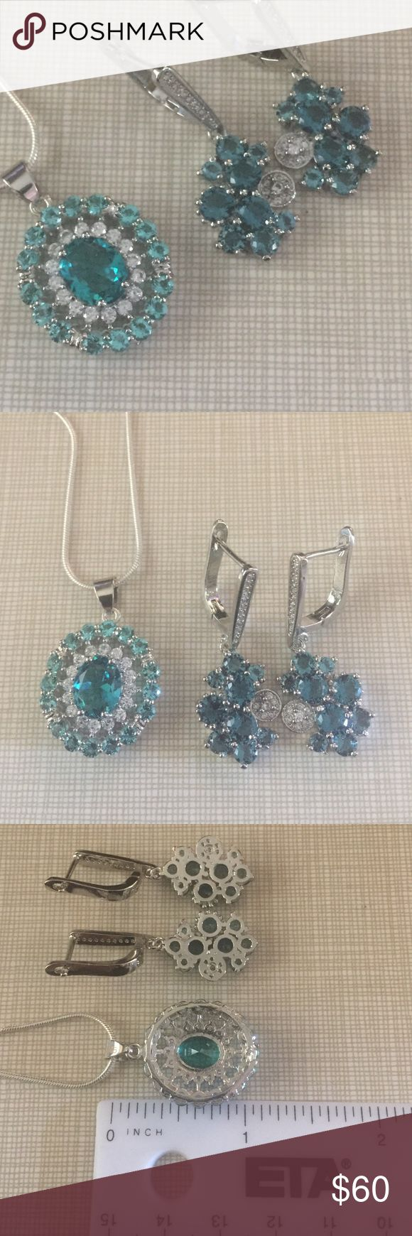 JUST in sophistication at its best aquamarine FIRM Pendant is 30x18 mm clarity of stone is IF to VVS treatment heated and filled faceted with cz stamped silver it is gorgeous earrings  London blue are 35x15 mm gemstone size is 5 mm clarity IF to VVS stunning and sophisticated NWOT price is my lowest FIRM Jewelry Necklaces