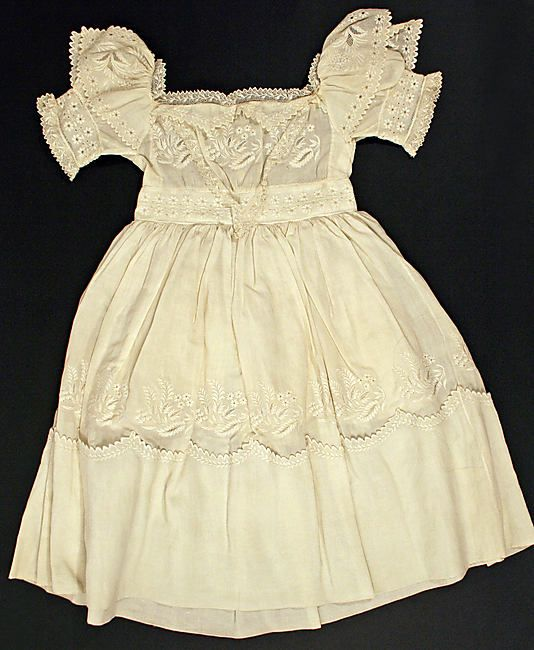From the Metropolitan Museum of Art-- A child's cotton dress, c. 1830.  Check out this link.  There is an excellent zoom function so you can see the exquisite details on this dress.