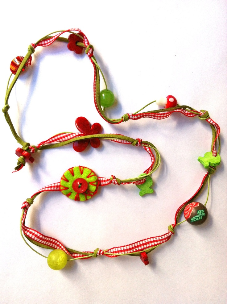 Red and green necklace with felted handmade circle and beads  (made to order). $20.00, via Etsy.