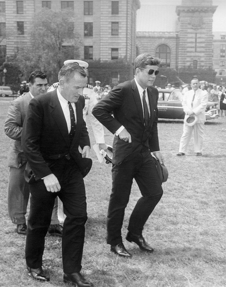 """President John F. Kennedy, Under Secretary of the Navy Paul B. """"Red"""" Fay, en route to the Commencement Ceremony at the United States Naval Academy in Annapolis. June 7, 1961"""