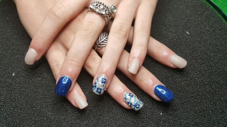 Nail design to match the dress of a good friends daughter for her 18th...lace design done by hand..